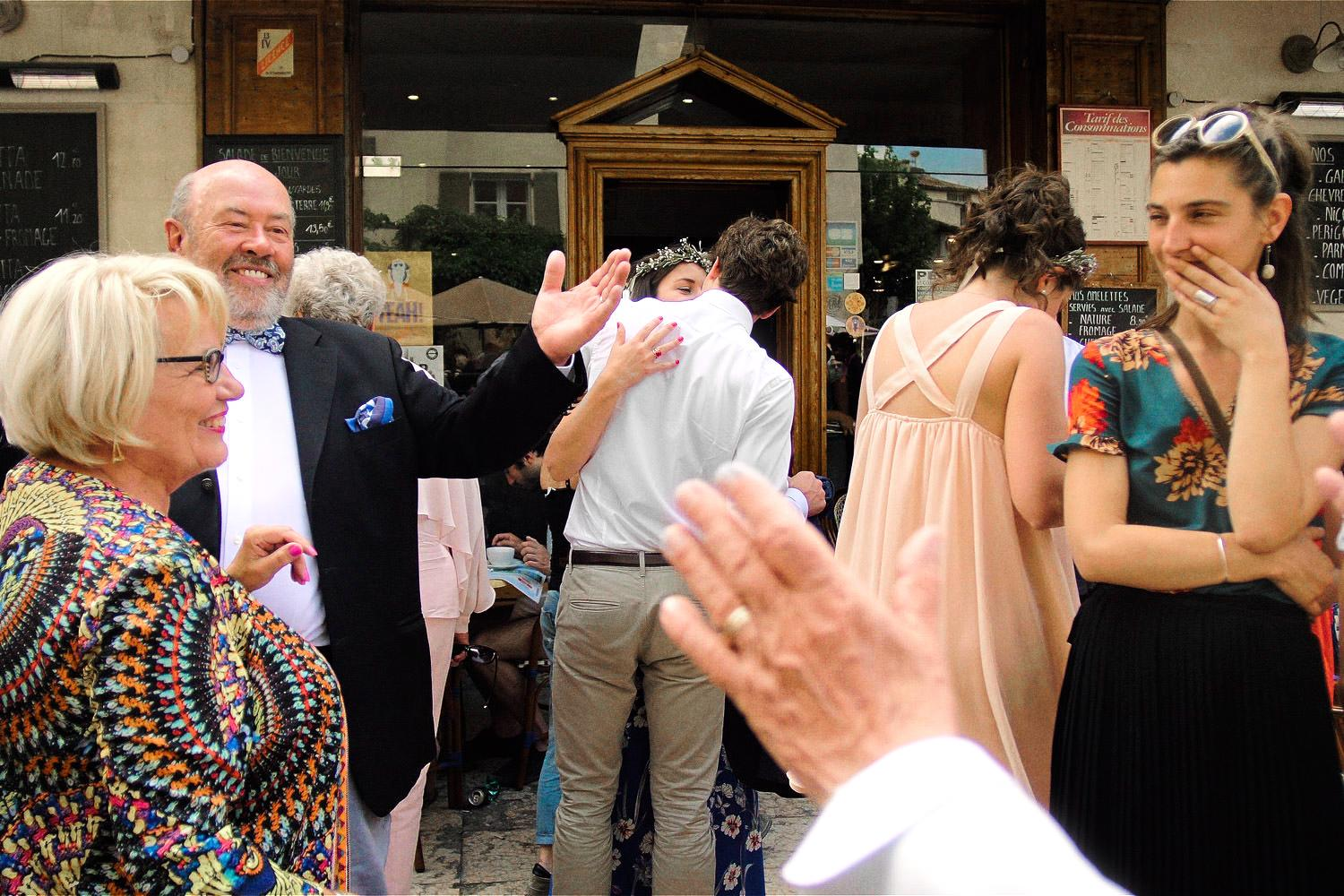 Wedding guests hug and greet each other in Lourmarin