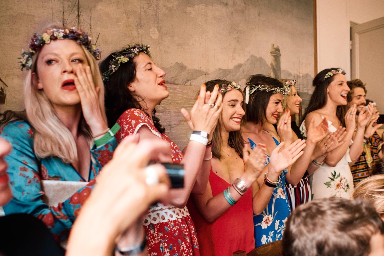 Emotional bridal party watch civil wedding proceedings