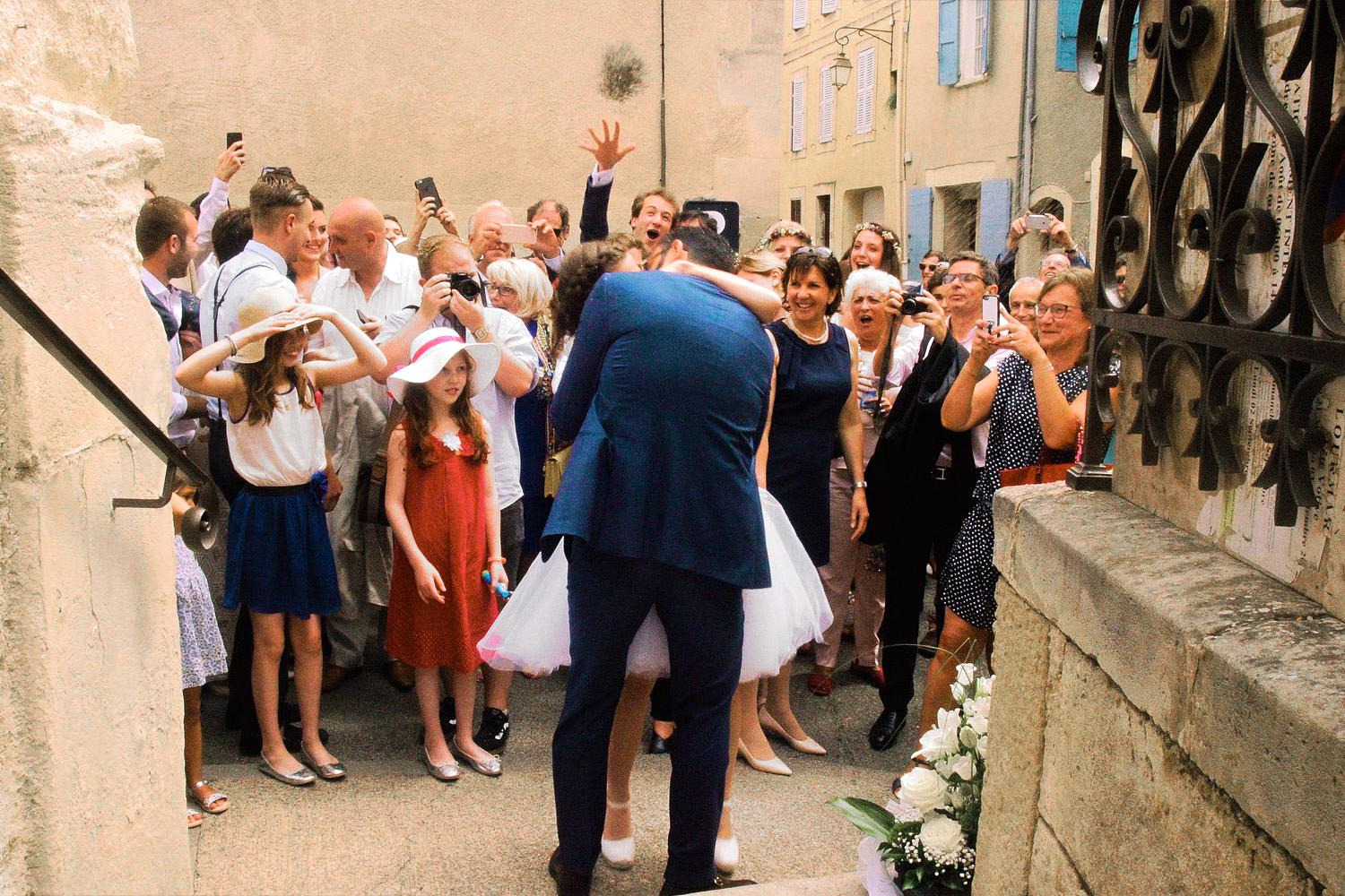 Confetti rains down on kissing French couple