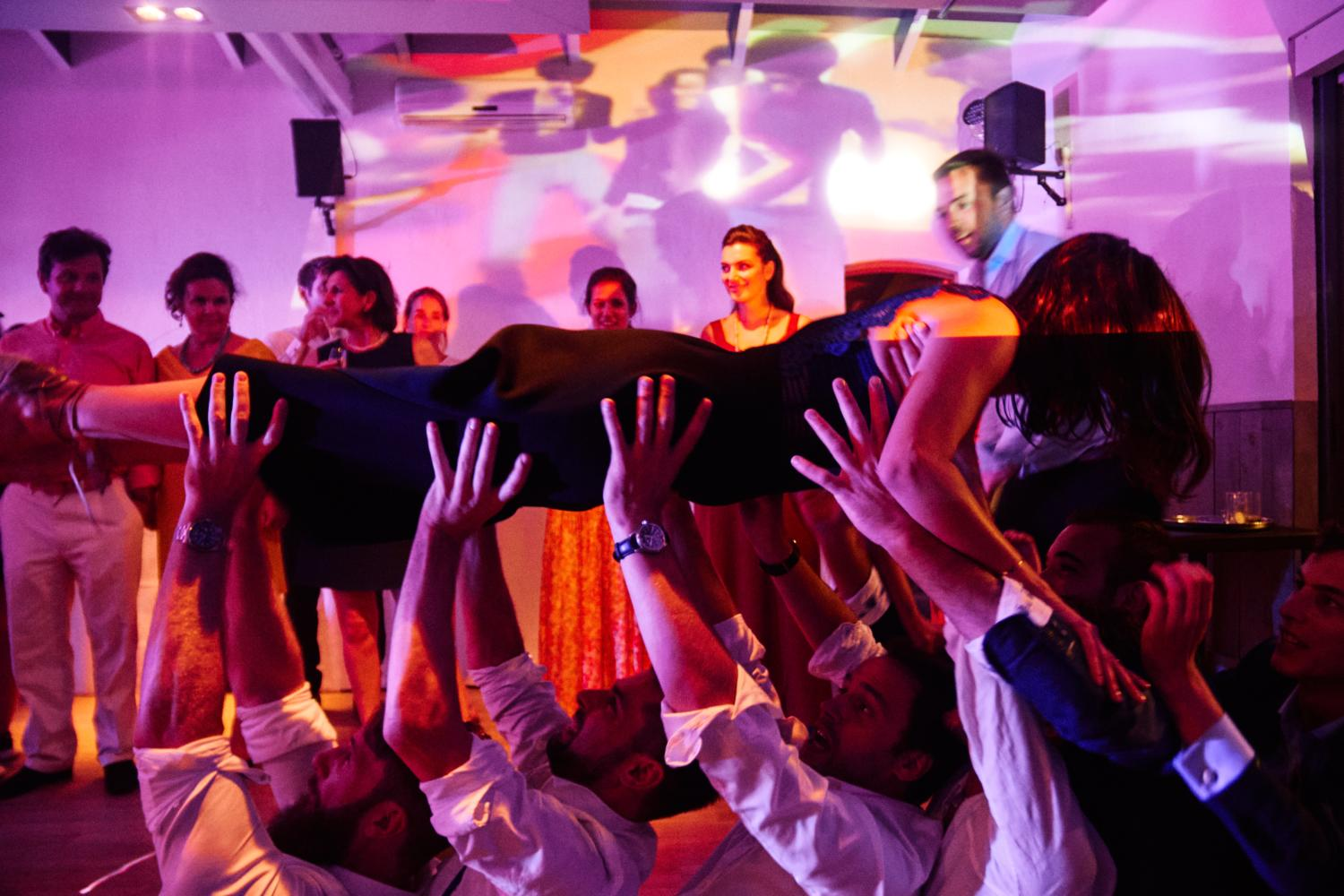 A wedding guest crowdsurfing on the dancefloor at Chateau Val Joanis