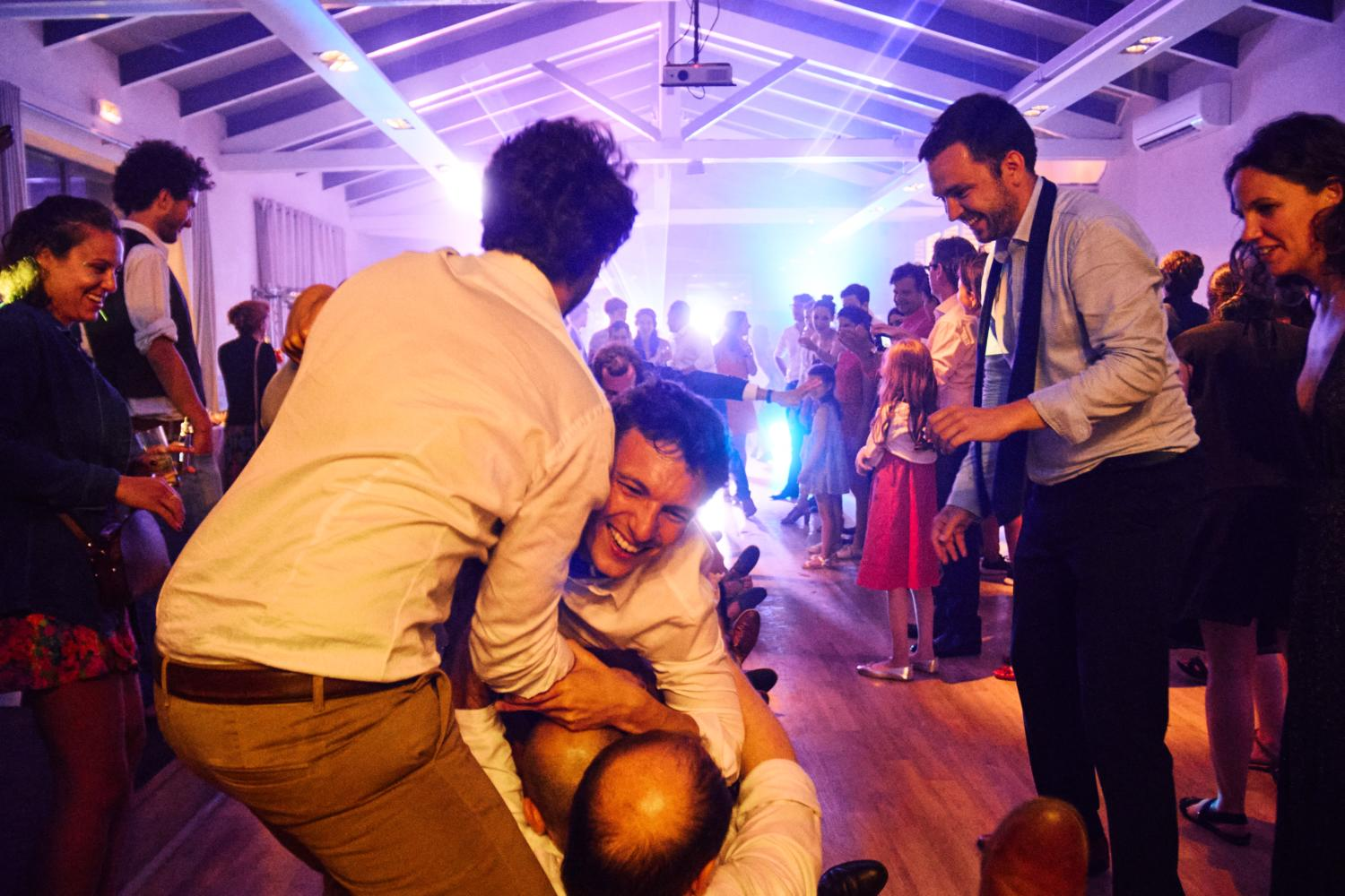 A man crowdsurfs at a wedding in France