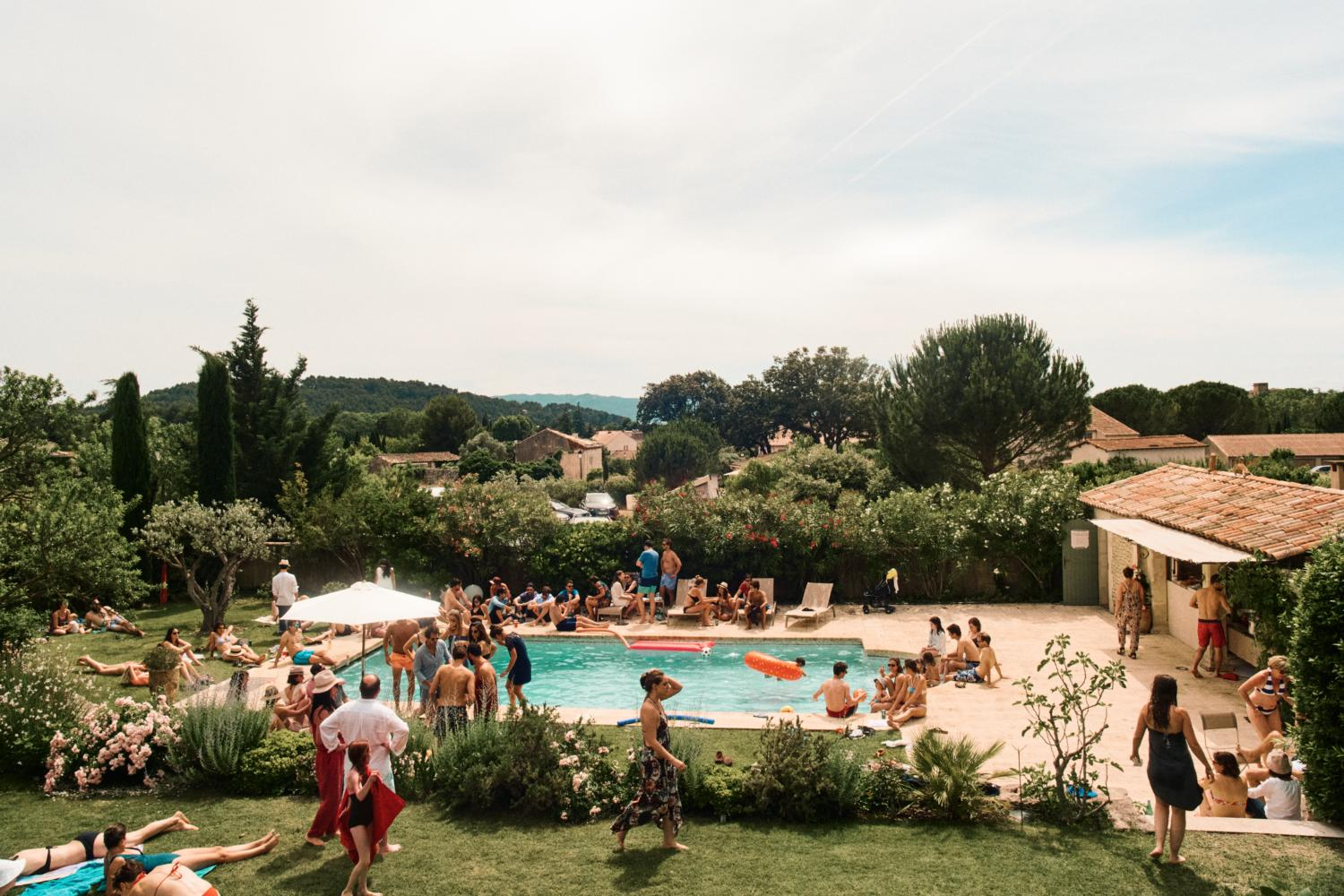 Guests relax at pool party in France