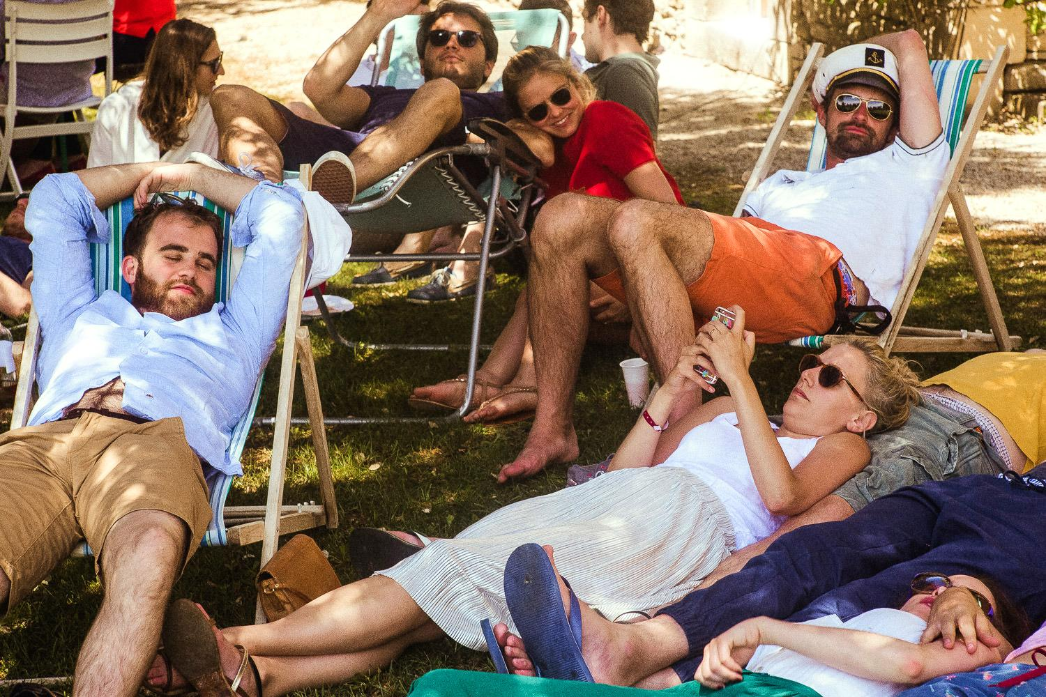 Guests sleep and relax at a French pool party
