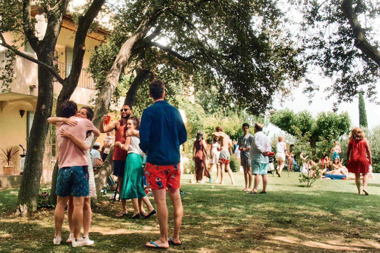Guests hug and say goodbye at a wedding pool party