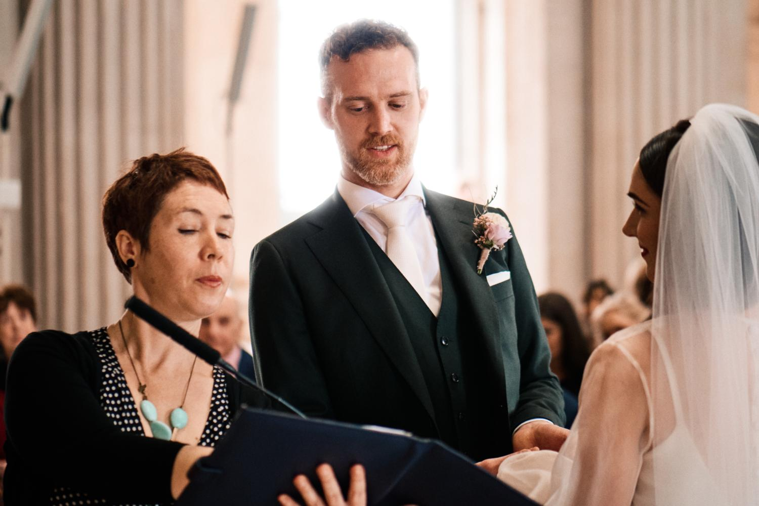 A groom reads vows during a Humanist ceremony at Dublin City Hall