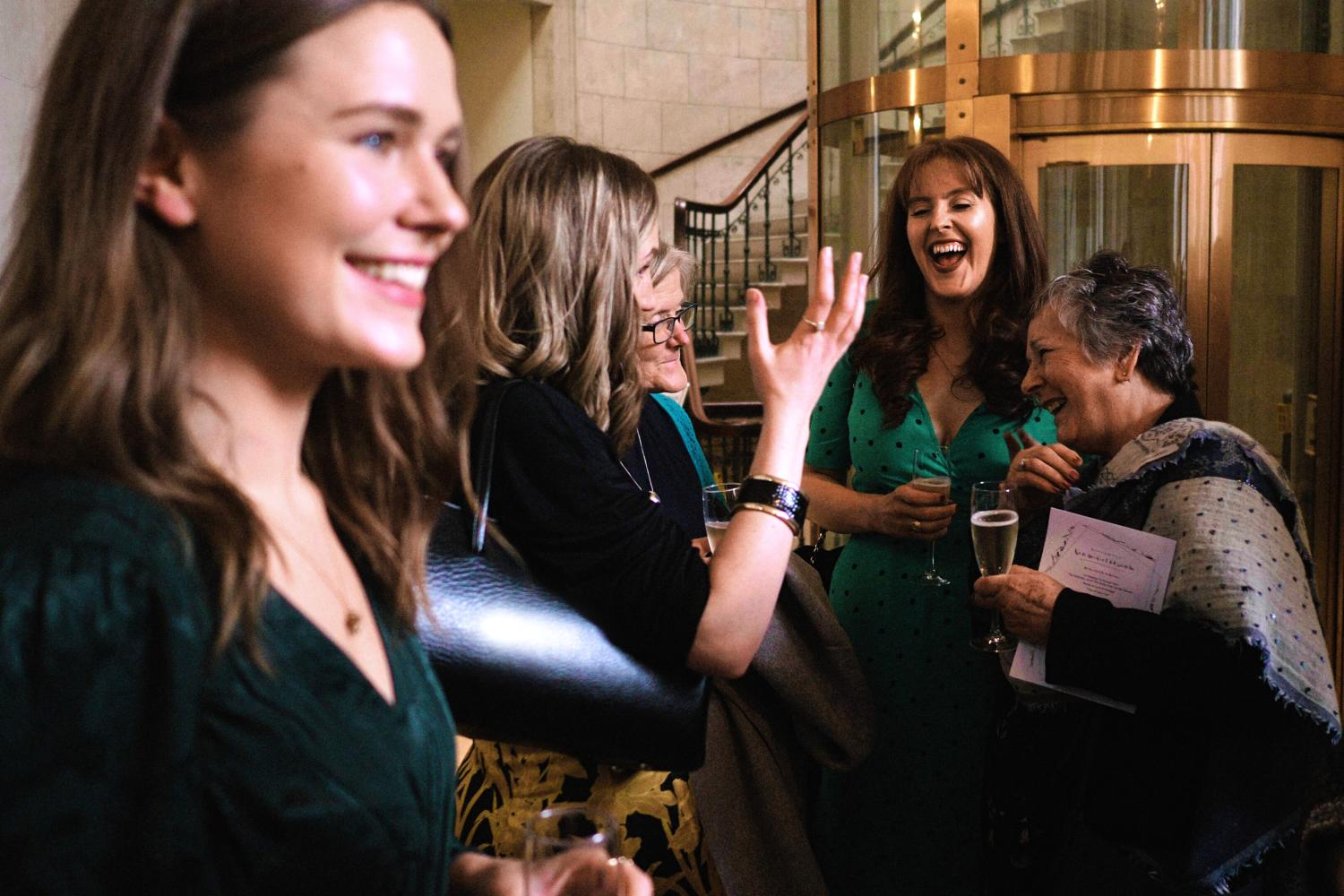 Women laugh at a drinks reception at Dublin City Hall