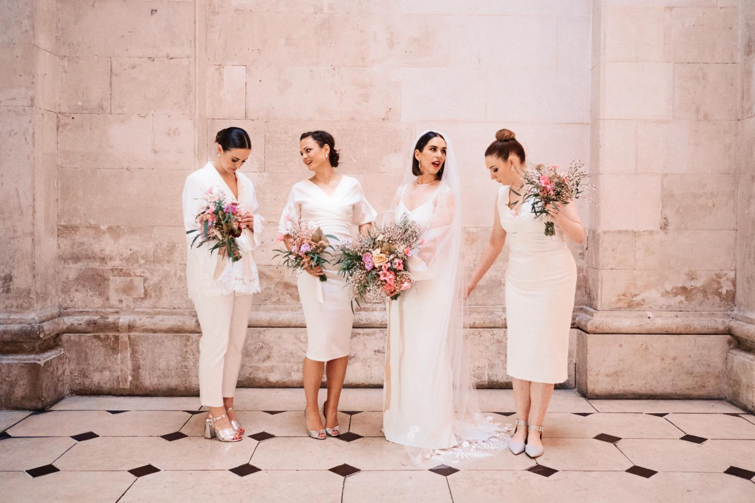 A chic bridal party prepare for a photograph at Dublin City Hall