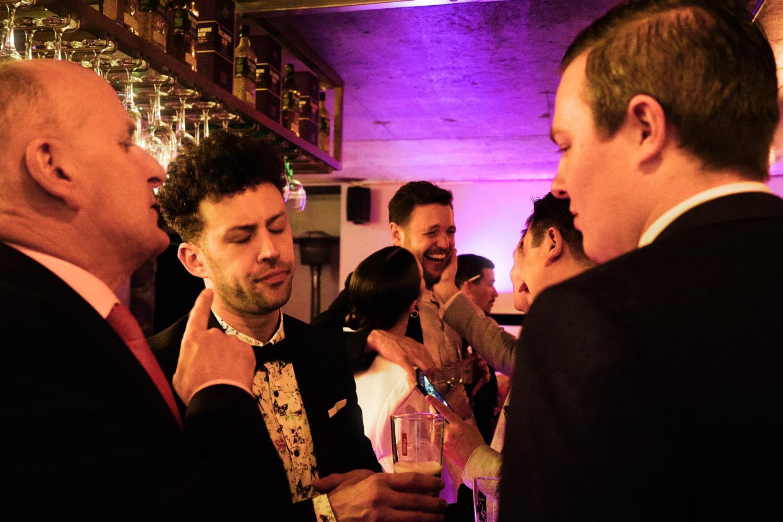 Wedding guests drink and talk at the bar at Medley, Dublin