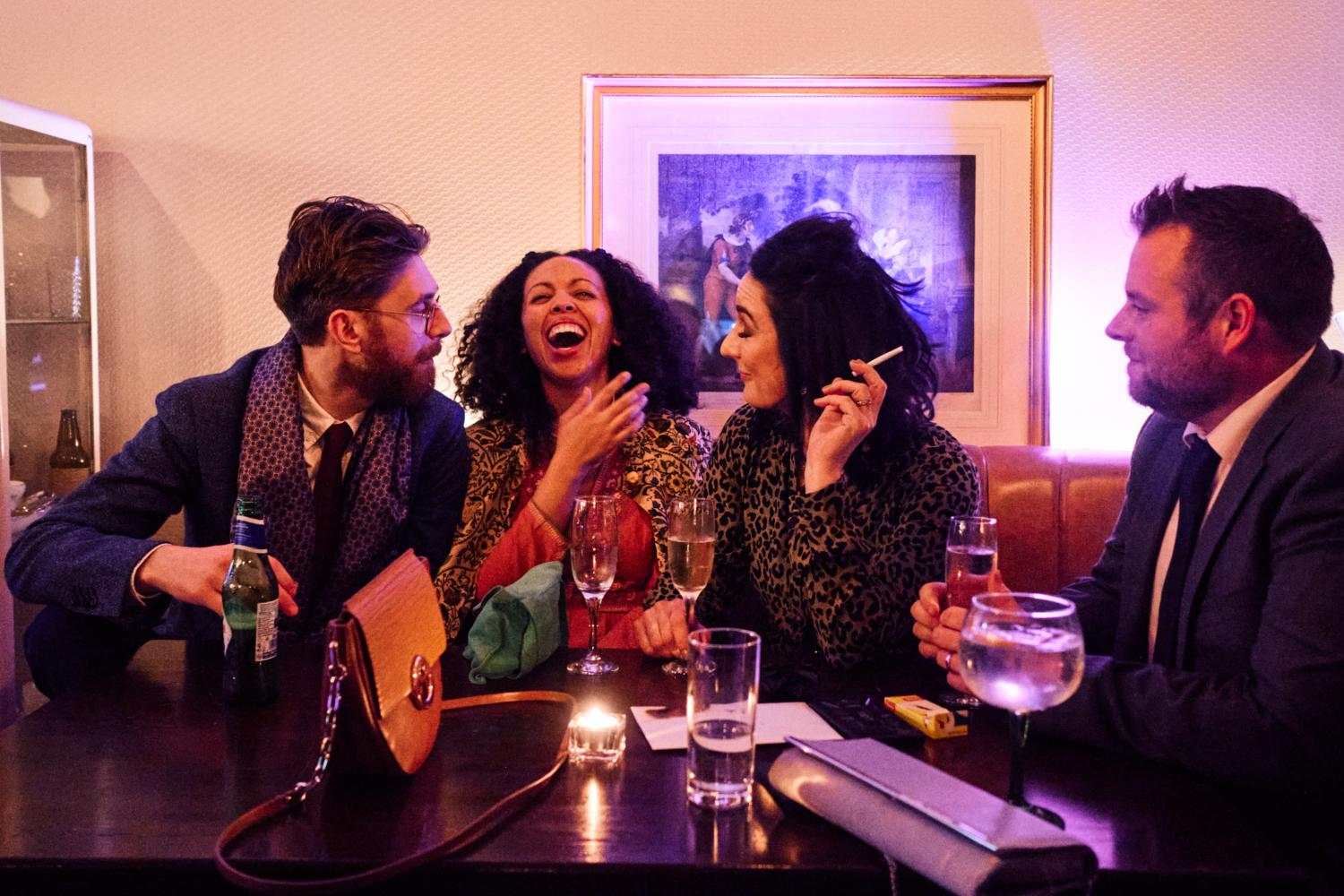 Guests laugh while sitted at a table in Medley, Dublin