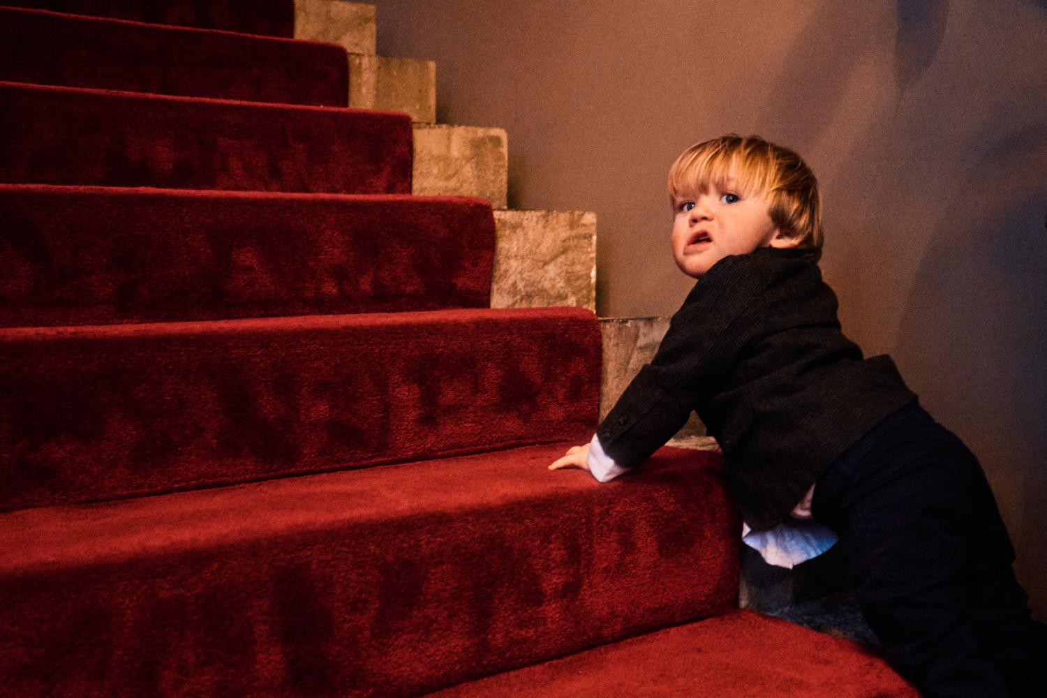 A child tries to climb up stairs at Medley, Dublin