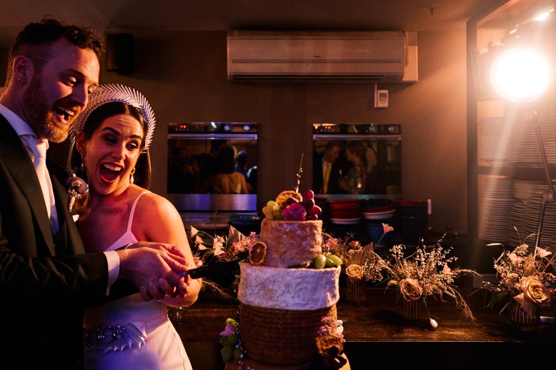 A couple cut a wedding cheese cake at Medley, Dublin