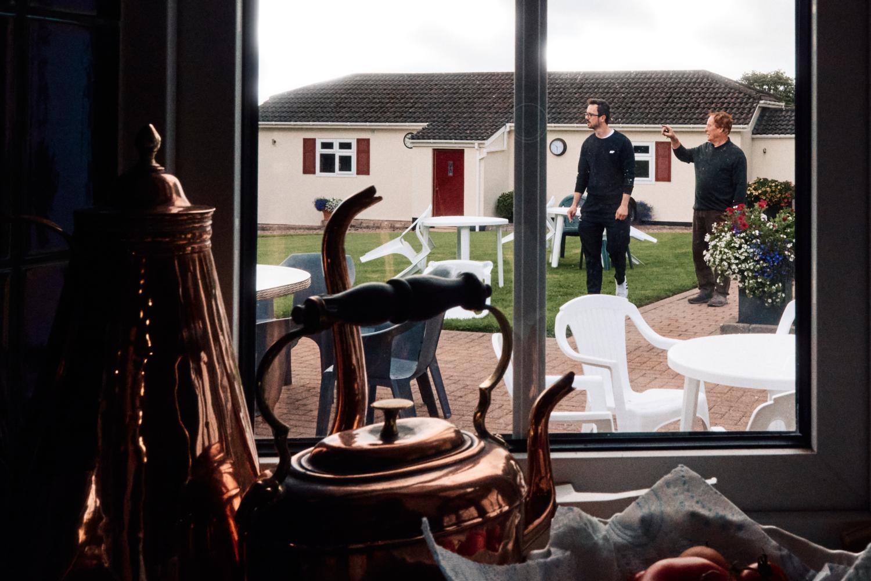 A father and son prepare a garden for a wedding reception