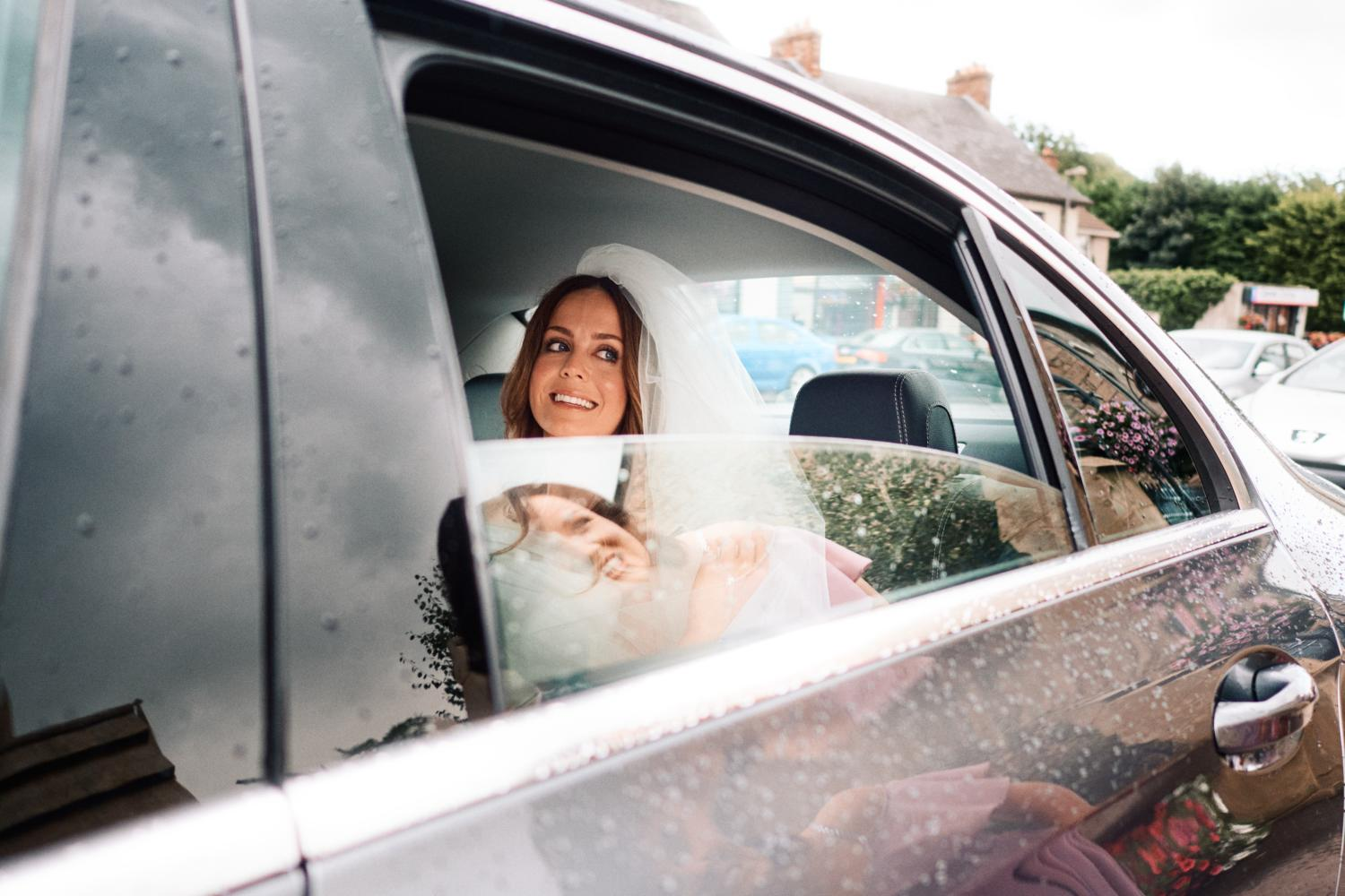 A bride arrives in a car at Dungannon Catholic Church