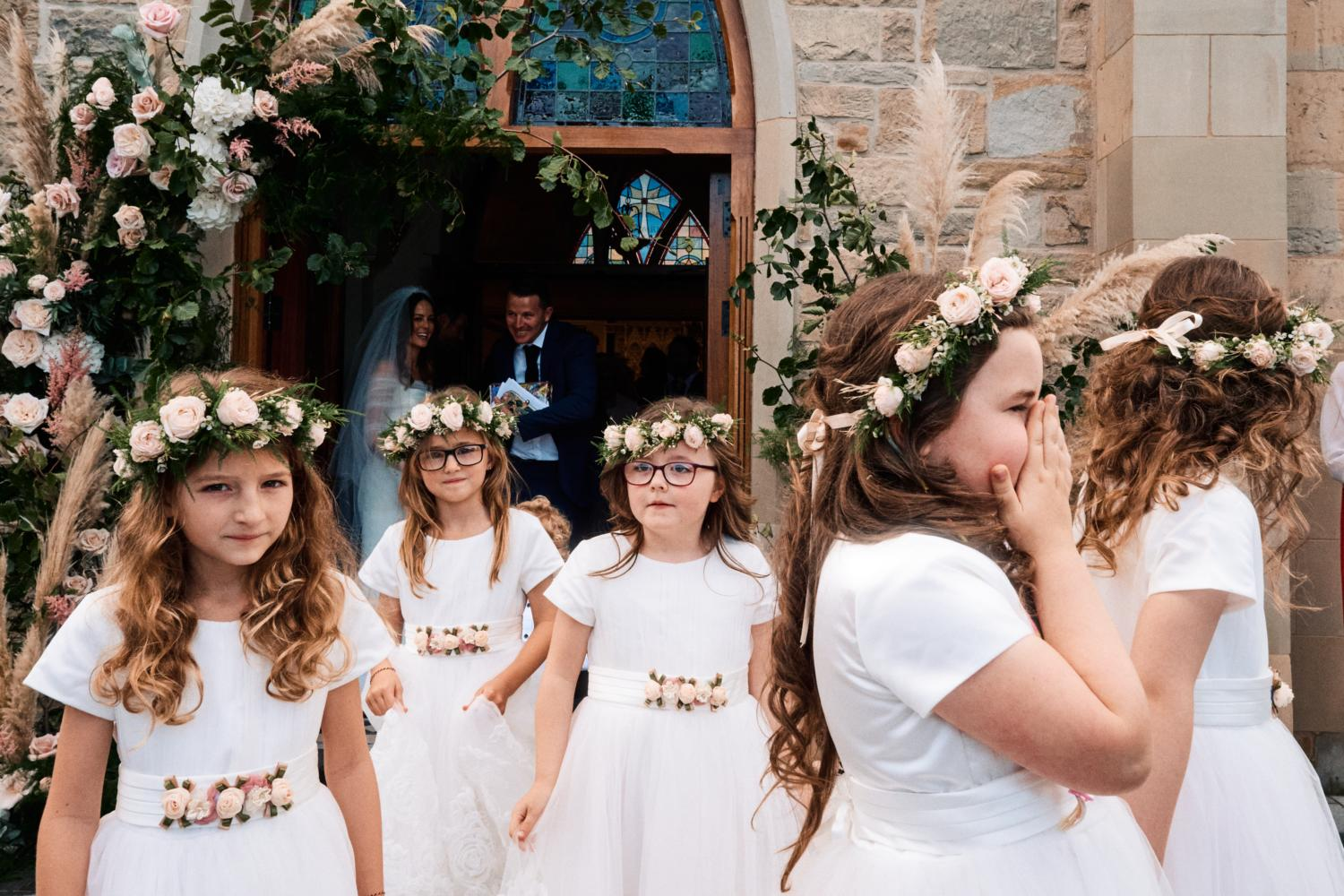 Five flower girls wearing floral head pieces
