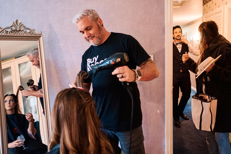 Wedding hairdresser styles bride's hair