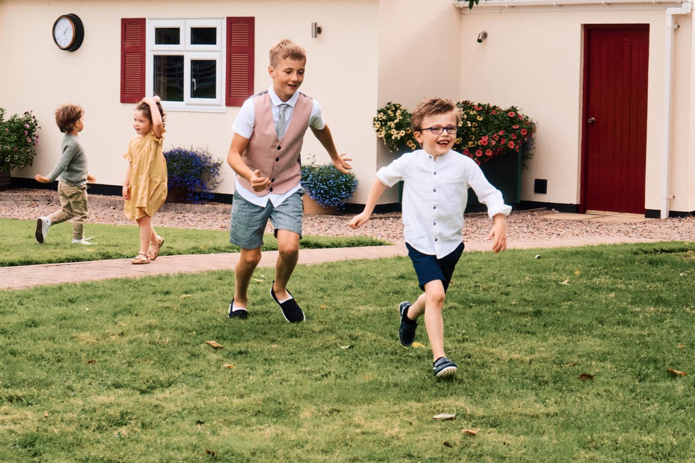 Children play at a wedding garden reception