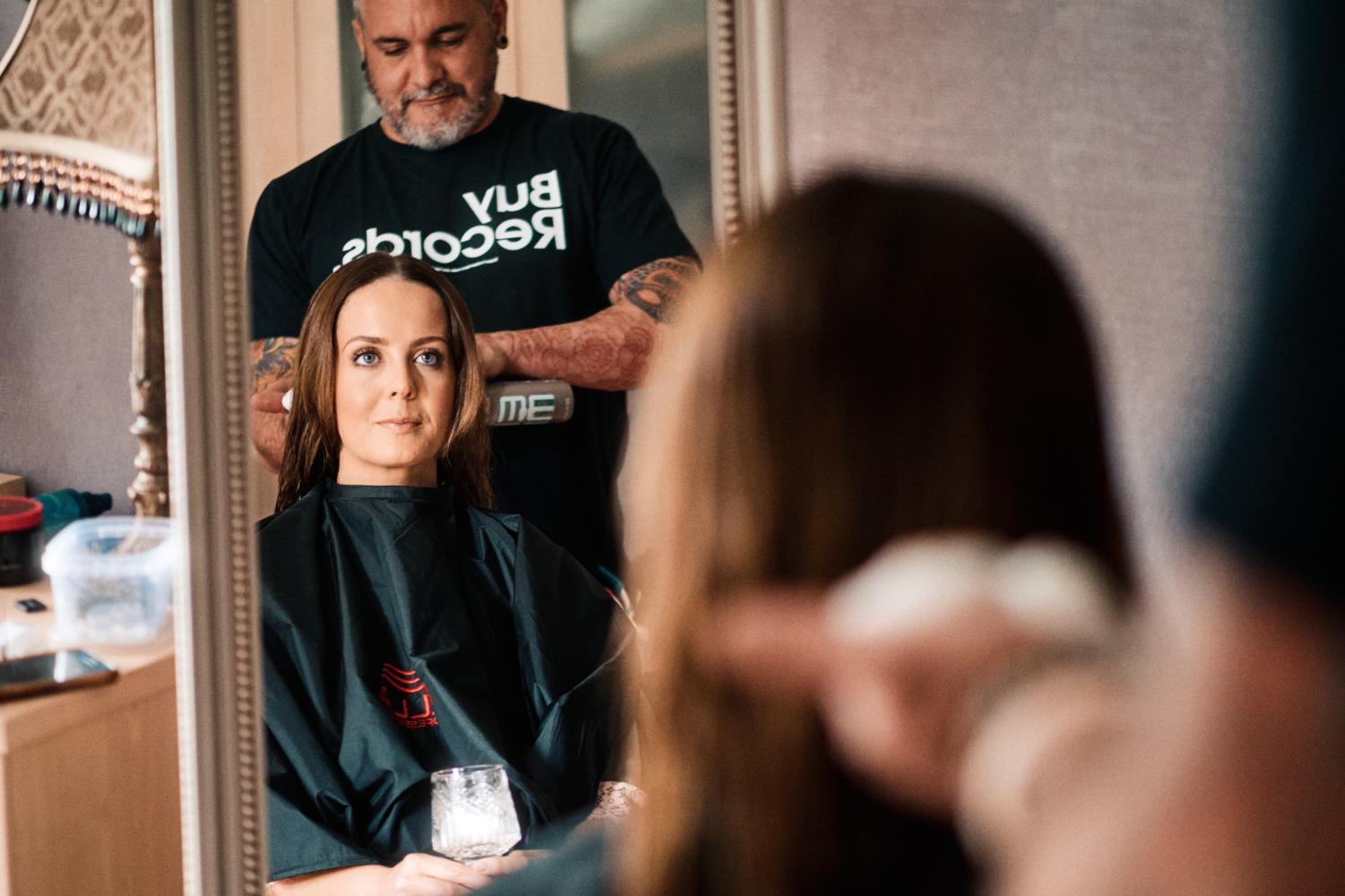 A hairdresser works with a bride on a wedding morning