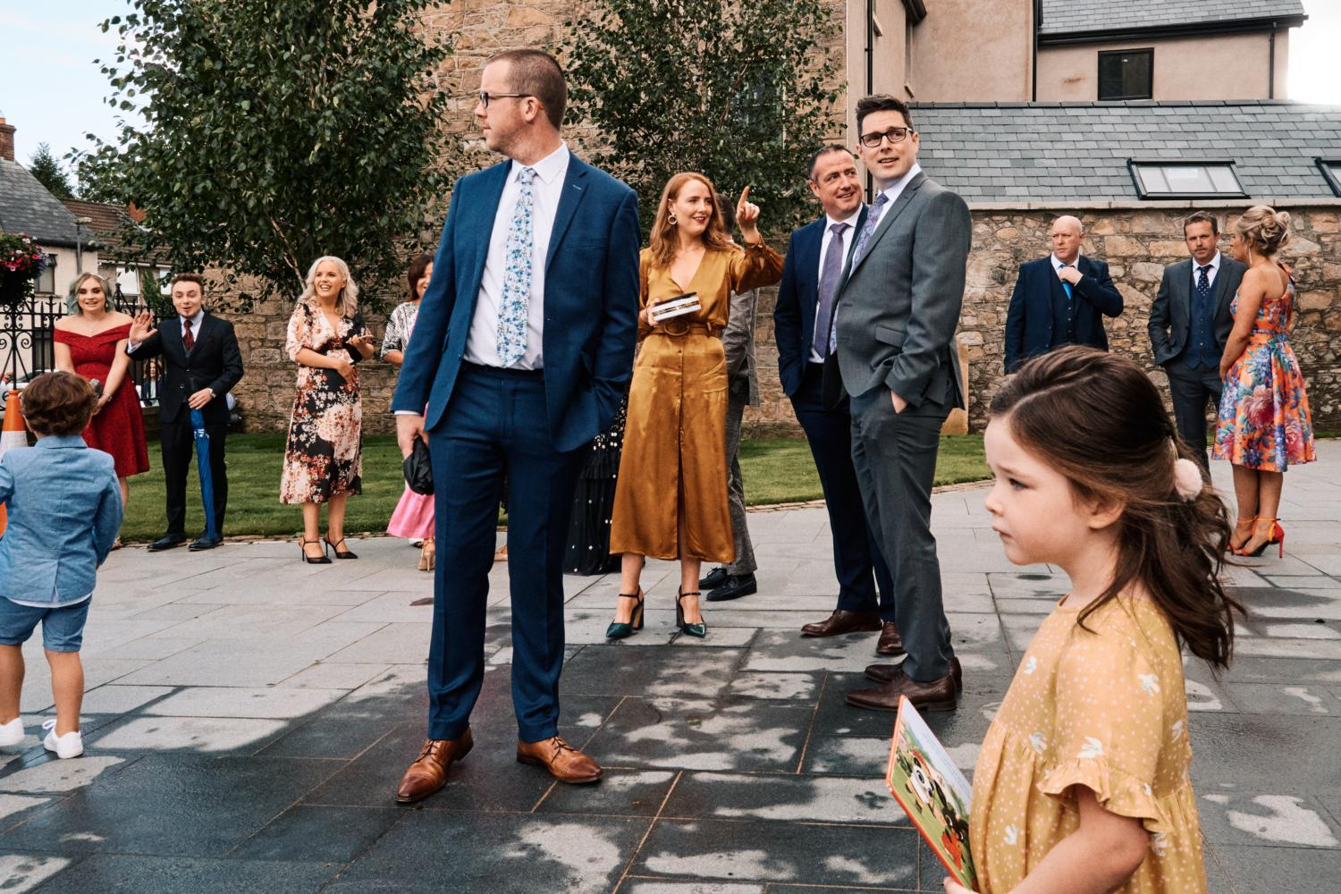 Wedding guests congregate outside a chapel in Dungannon