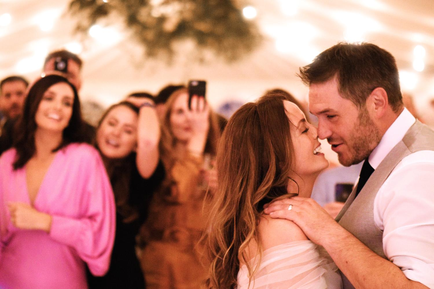 Bride and groom dancing in a marquee