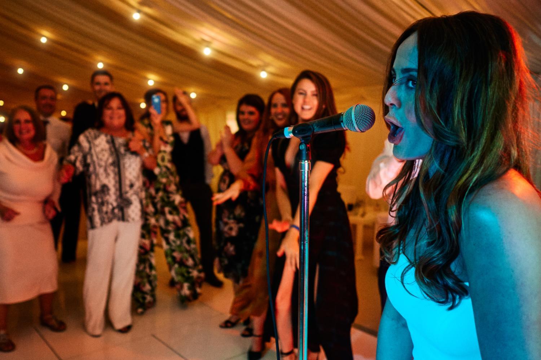 Bride sings at her wedding