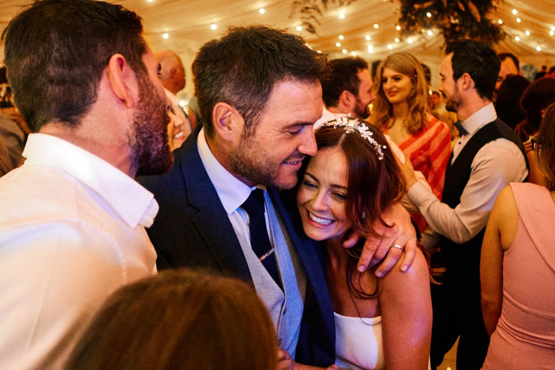 Bride and groom hug on the dancefloor