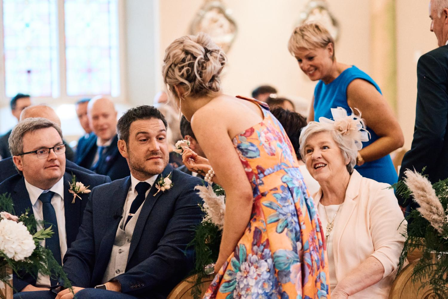 A groom receives a flower before a wedding ceremony in Dungannon