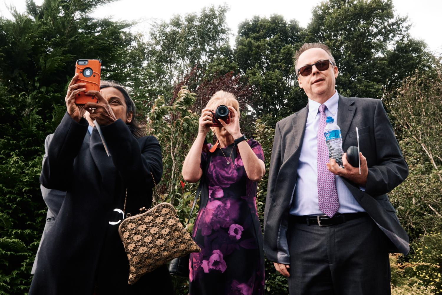 Three photographers at a wedding
