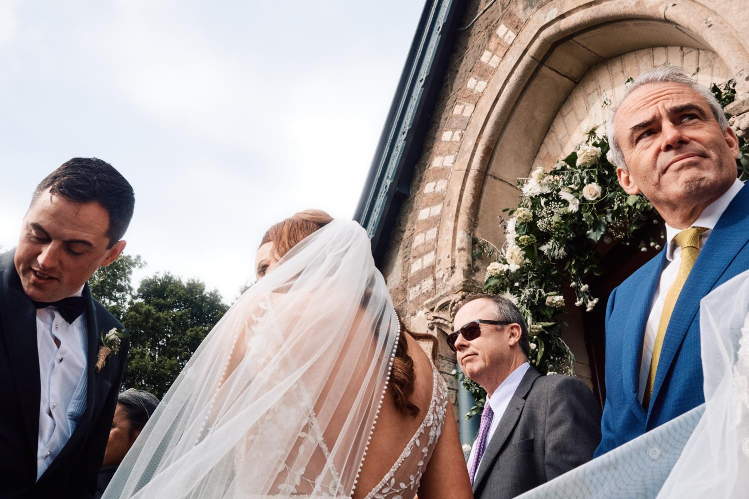 Wedding guests exit a chapel in Ireland
