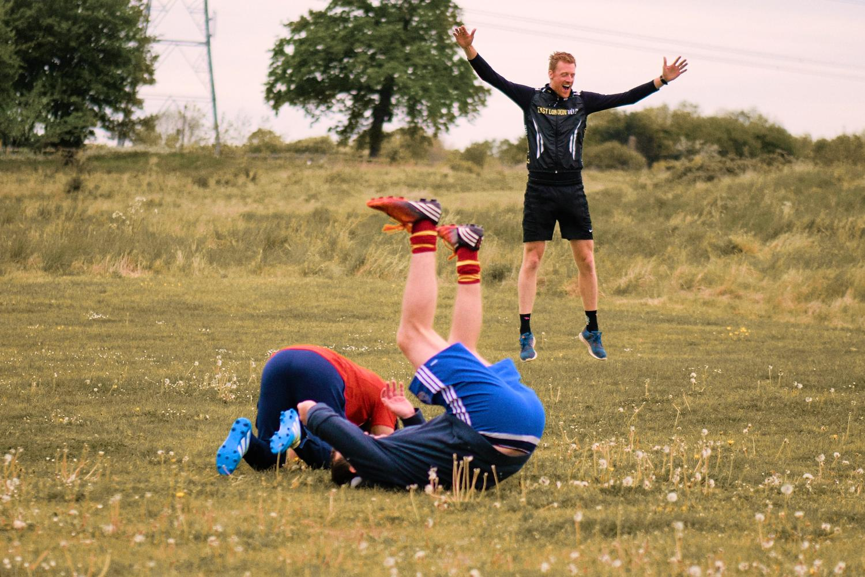 Groomsmen play football golf in Oxfordshire