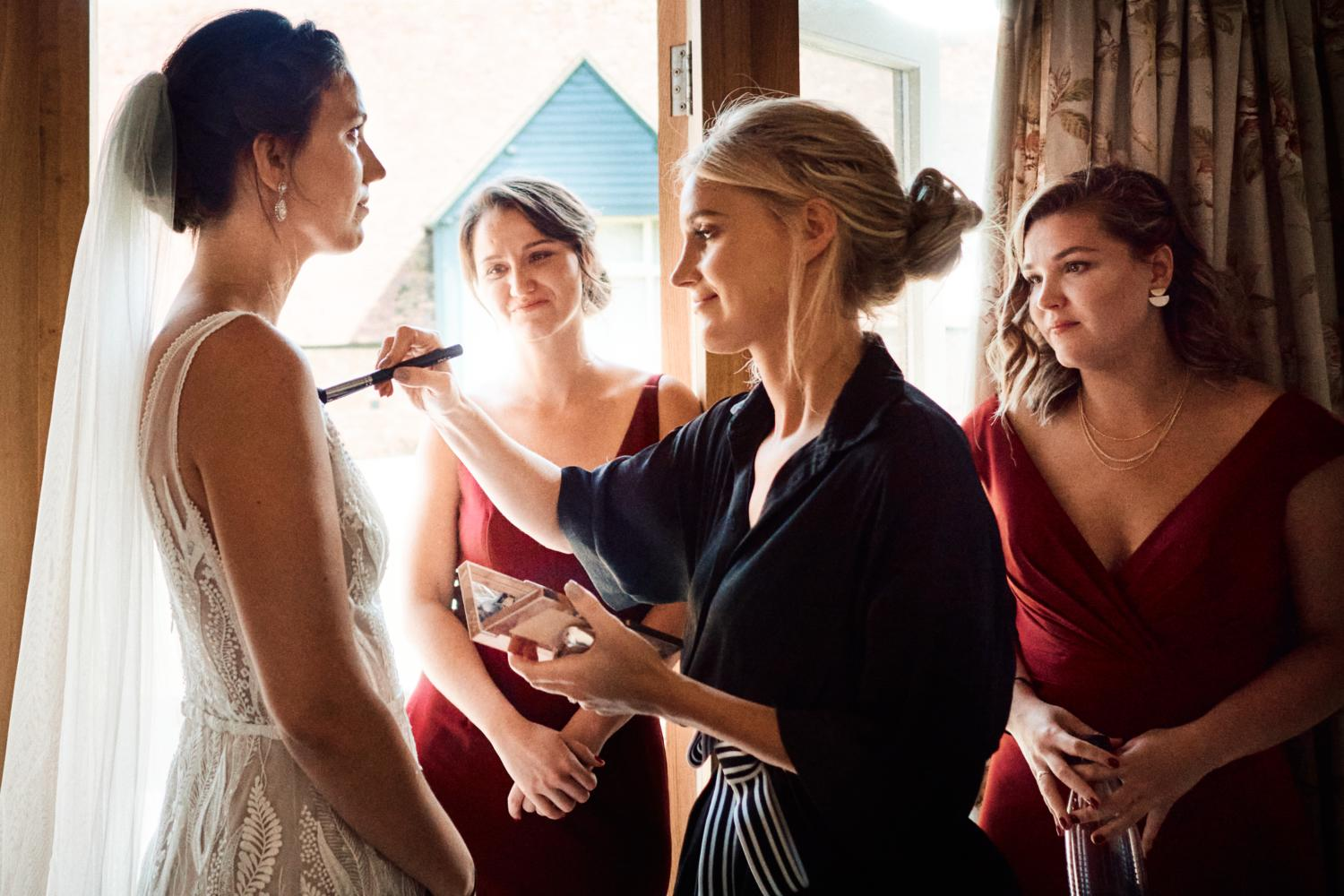 A sister looks affectionately at the bride