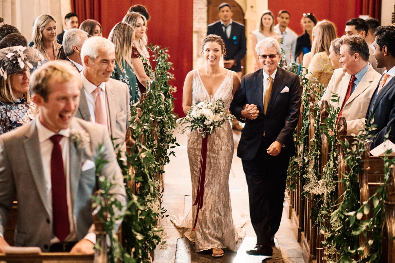 Bride walks up the aisle at Ewelme church