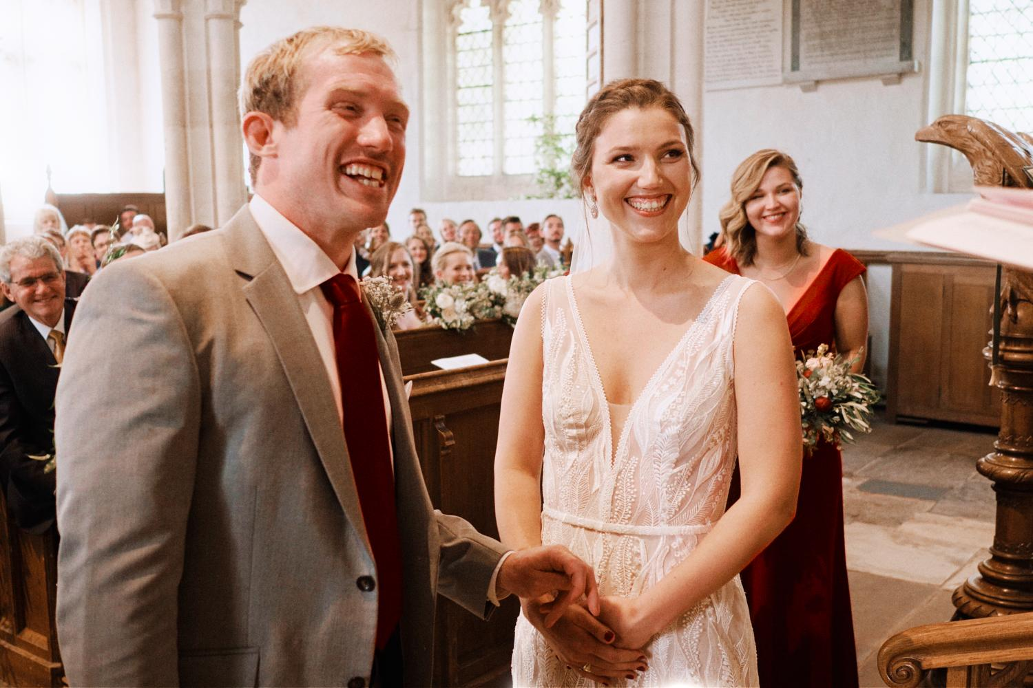 Bride and groom laugh during vows