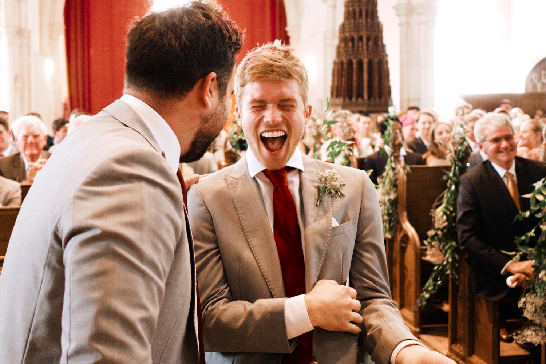 Laughing groomsmen during Ewelme wedding