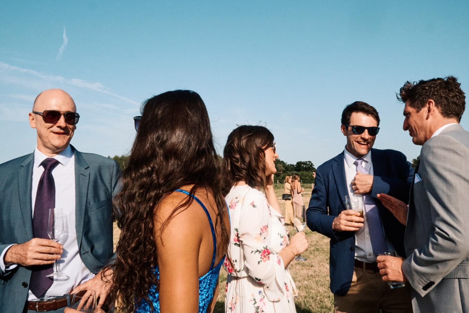 Wedding guests relaxing in a field
