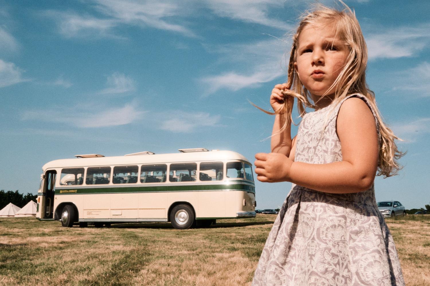 Child in front of a bus