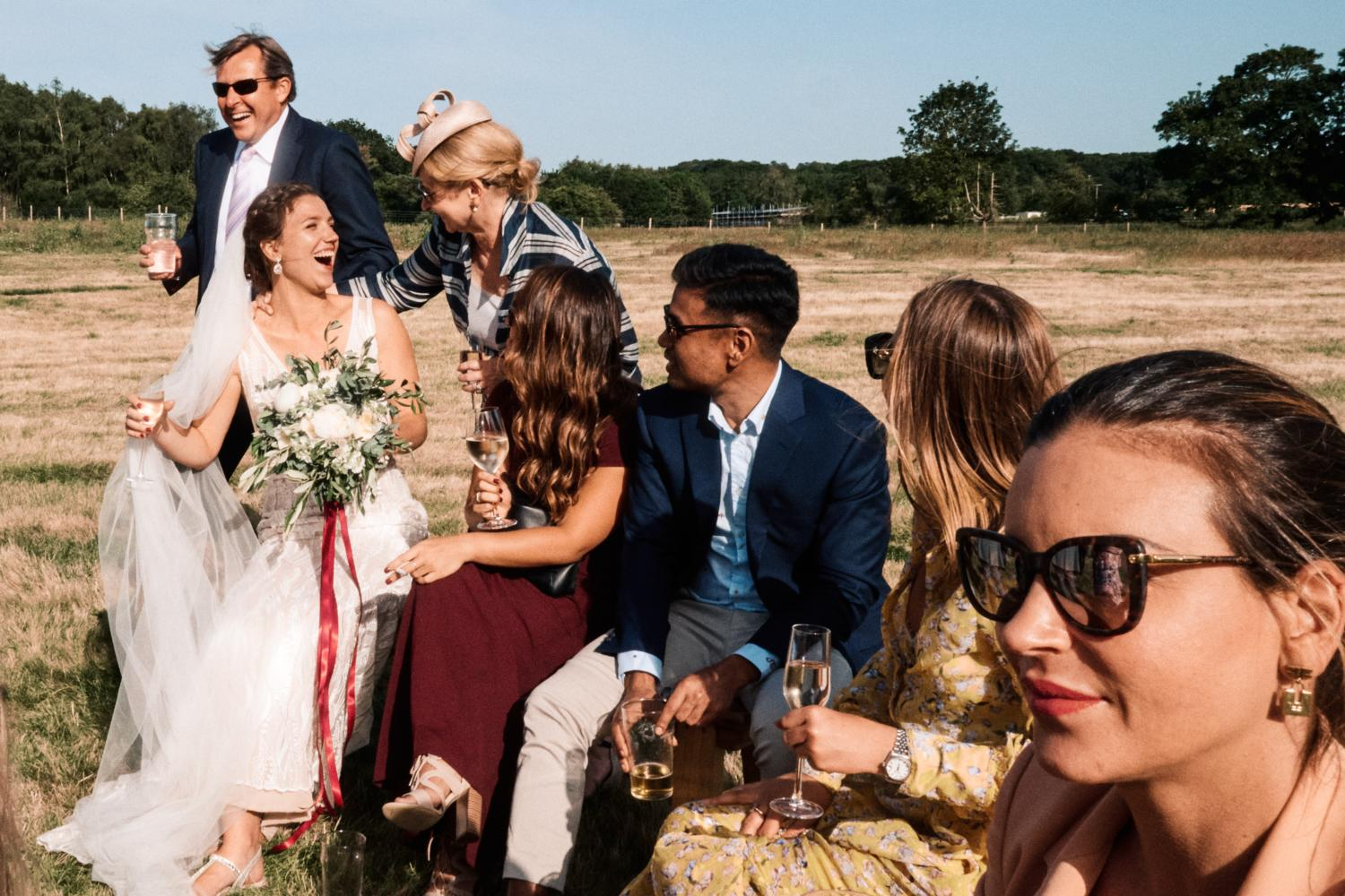 Bride and guests in a field