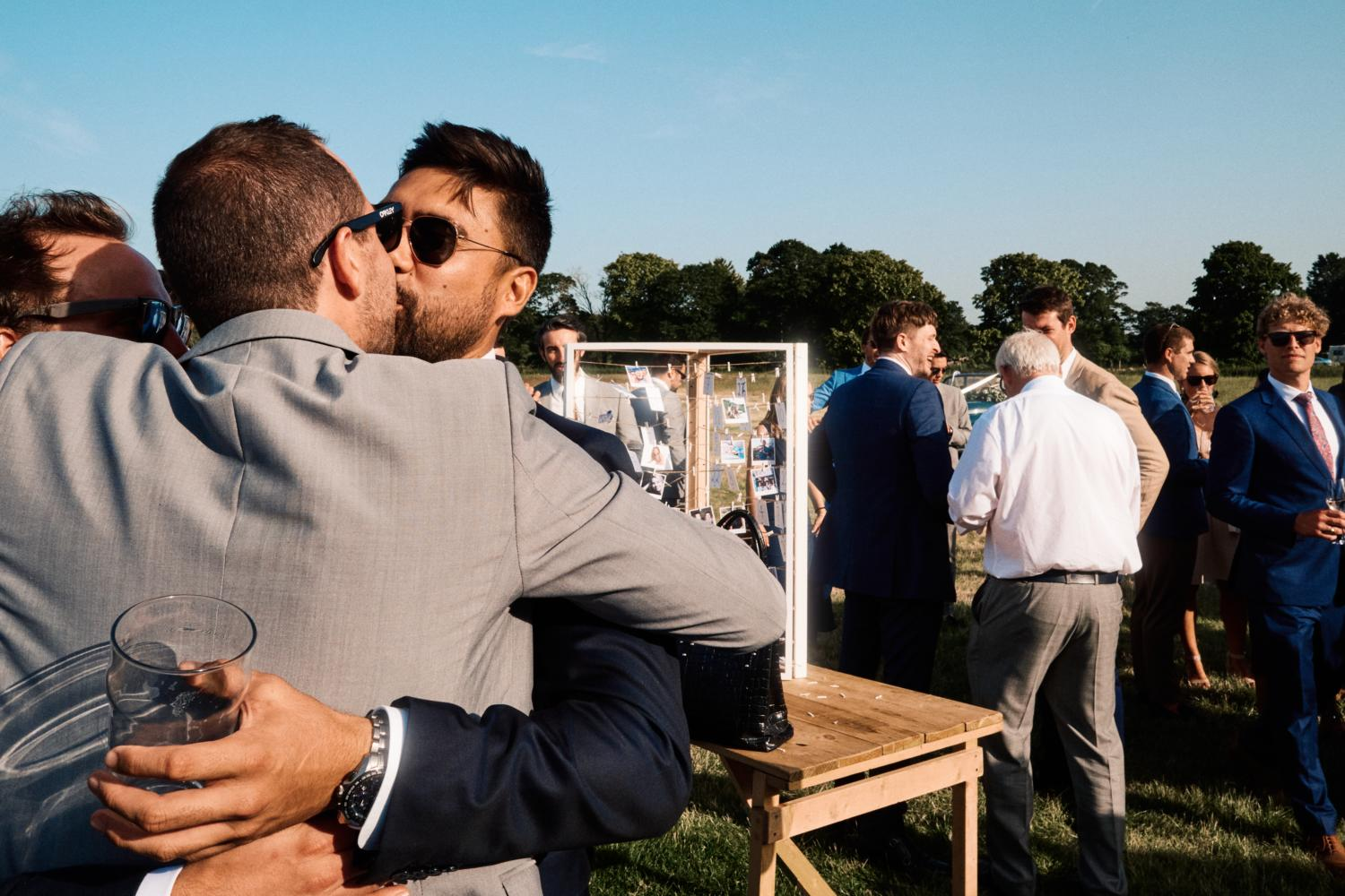 Guests kissing at Oxfordshire wedding