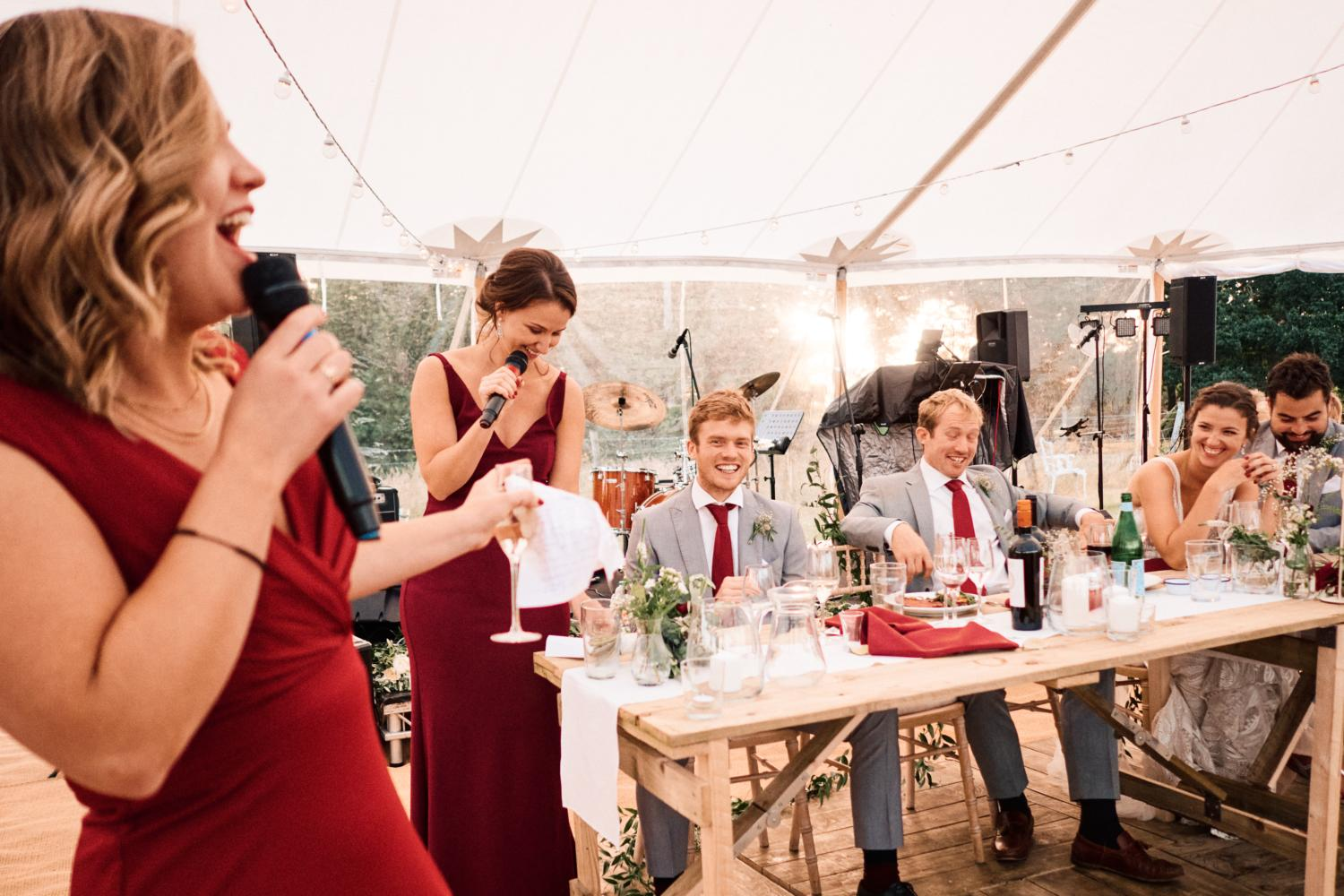 Sister of bride performs speeches in a marquee