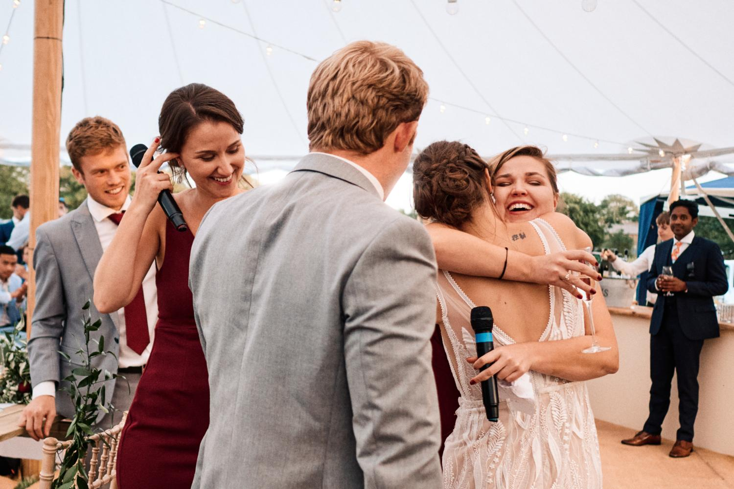 Bride hugs sister after speeches