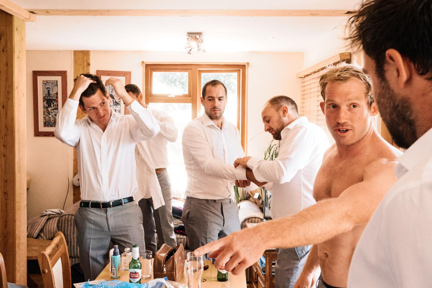 Groom and friends get dressed for wedding