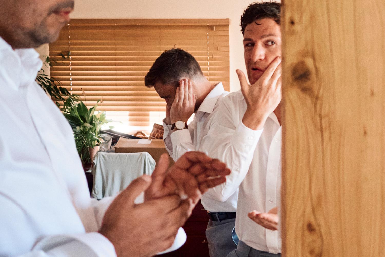 Groomsmen apply after shave on wedding morning