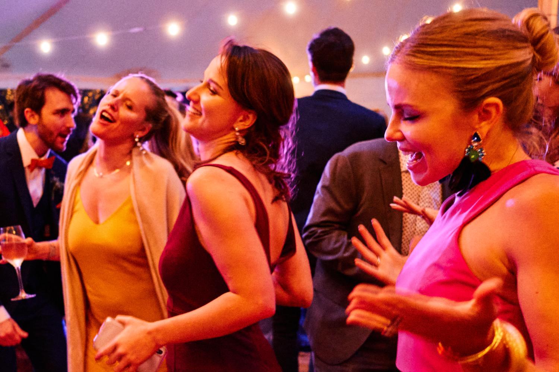 Expressive women dance on the dancefloor