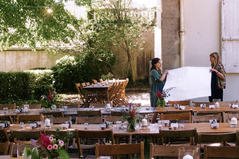 Fremcj Bridemaids prepare an outdoor garden wedding reception