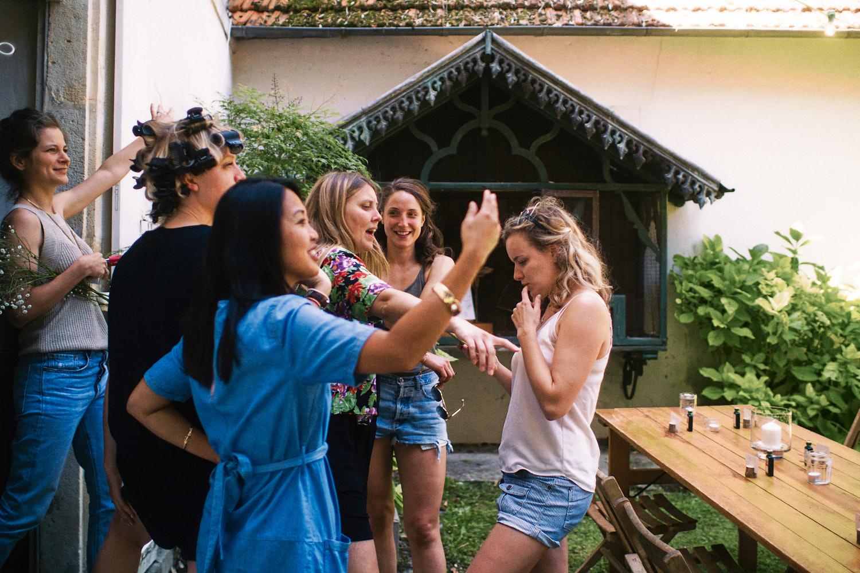 Bride organizing garden reception with bridesmaids