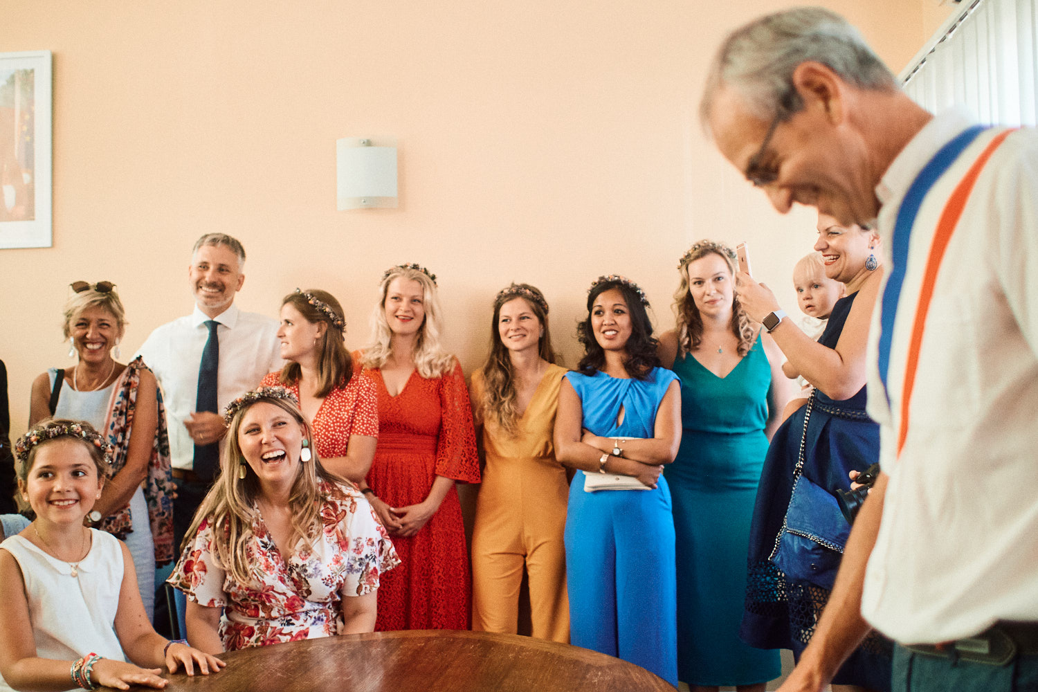 The mayor officiates a French wedding, witnessed by many colourfully dressed guests