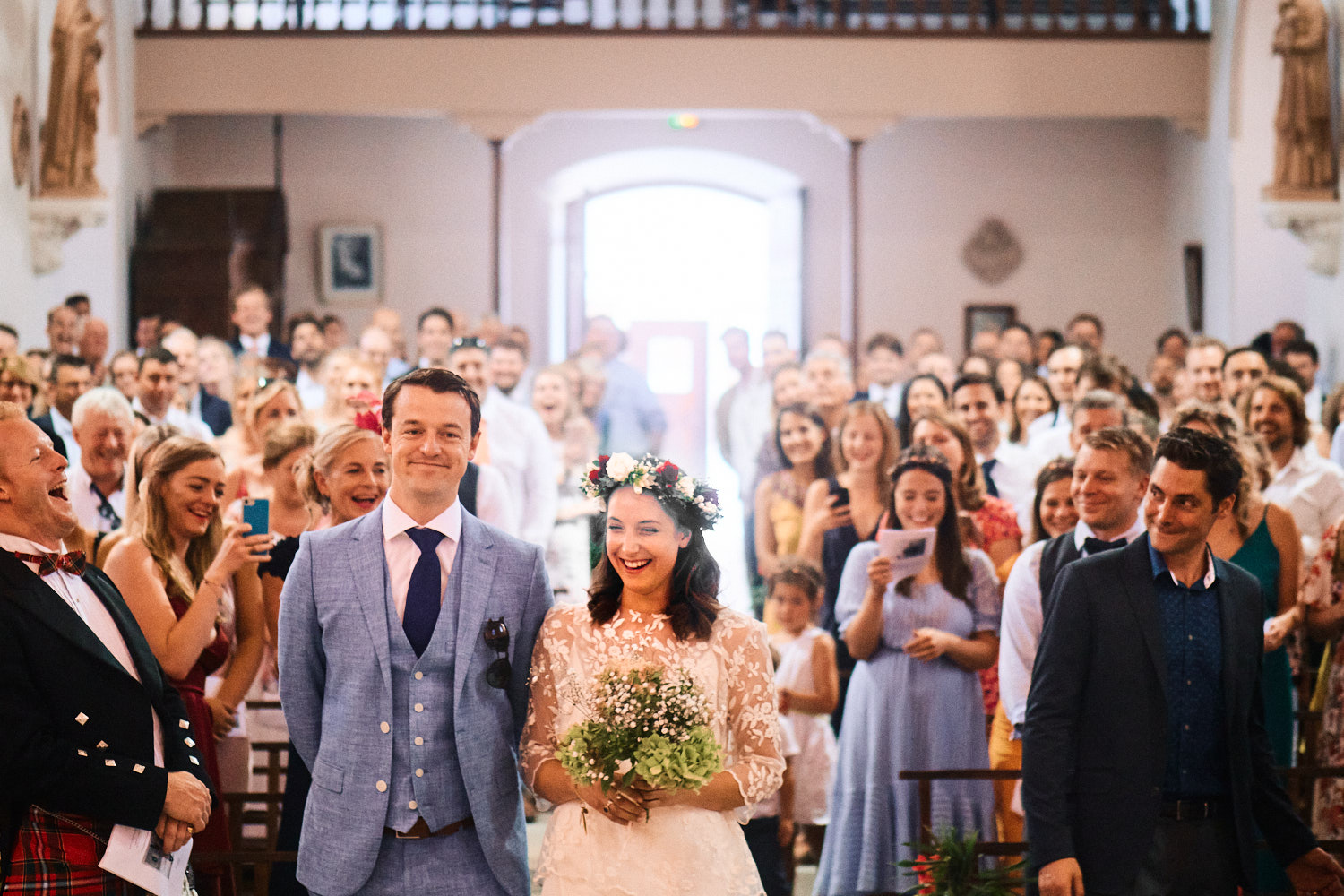 Bride and groom smile during French wedding ceremony