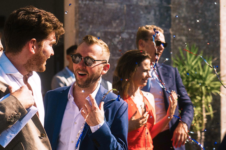 Guests enjoy confetti at wedding