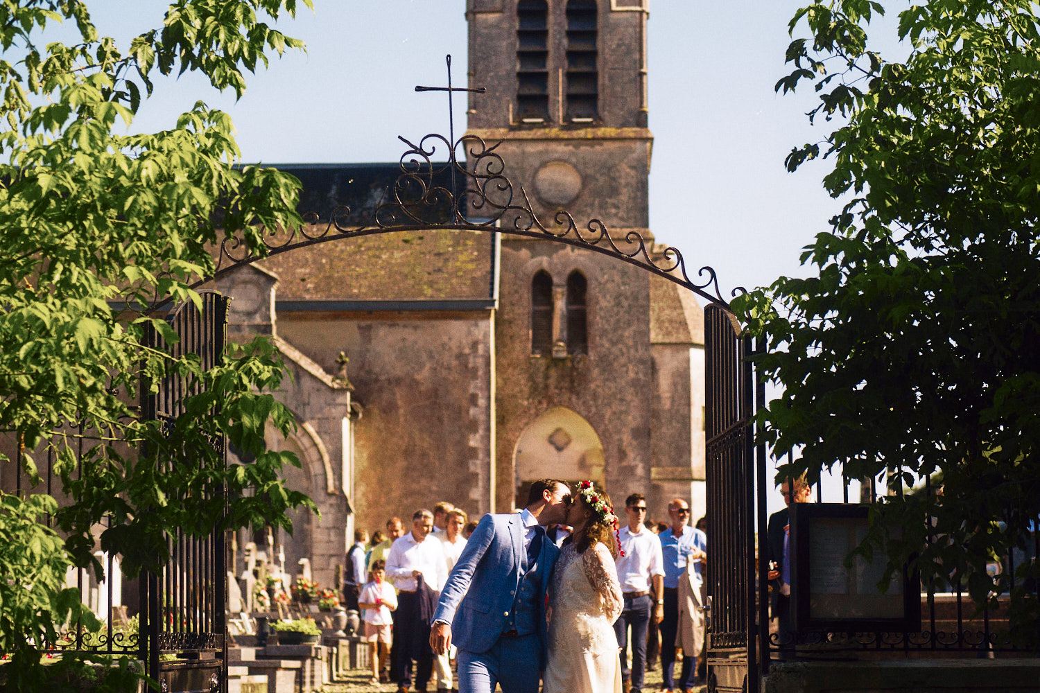Bride and groom kiss outside French chapel
