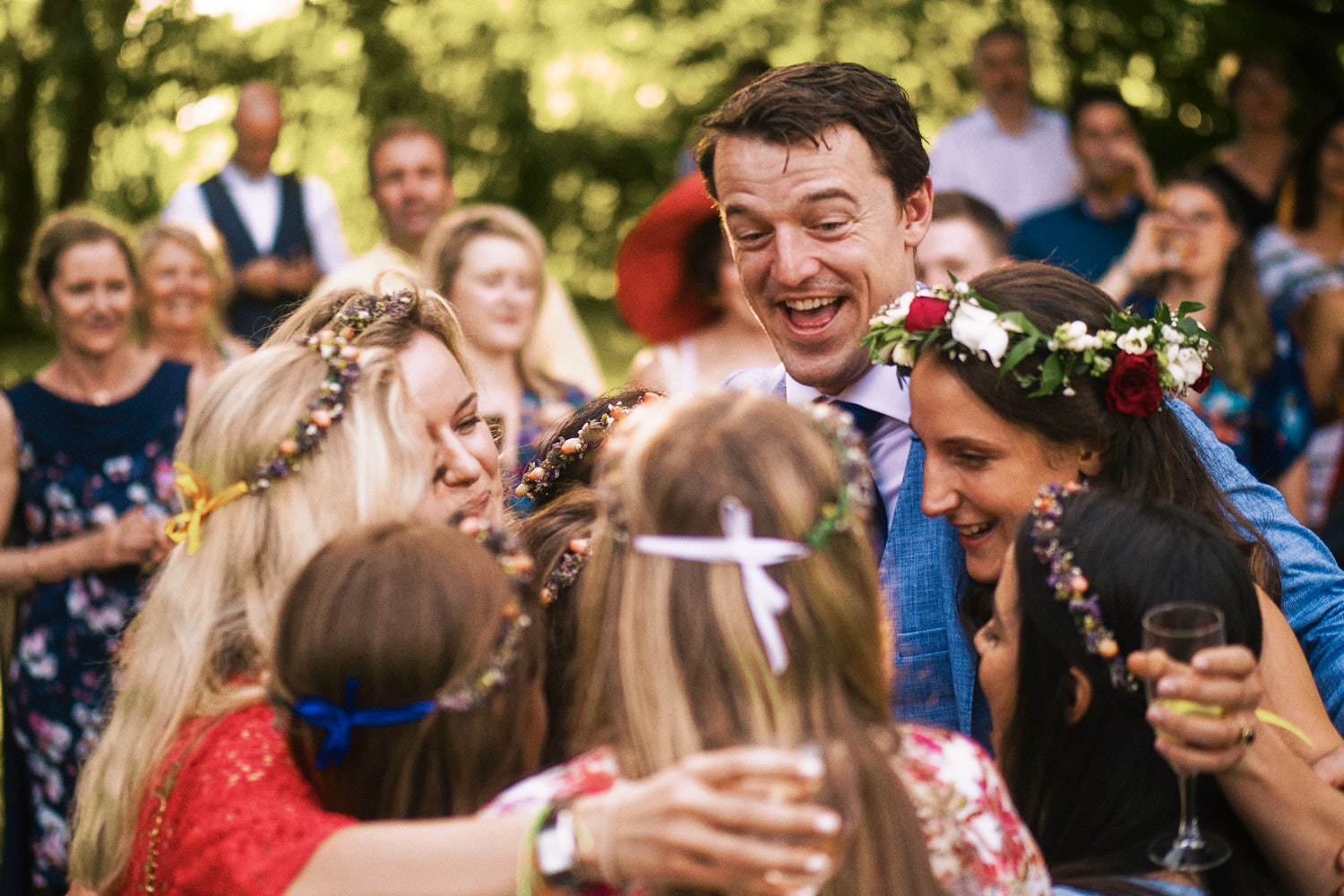 Bridal party hug each other during outdoor speeches
