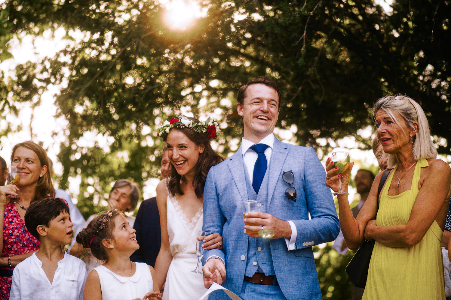 Bride and groom enjoy outdoor speeches in the sun